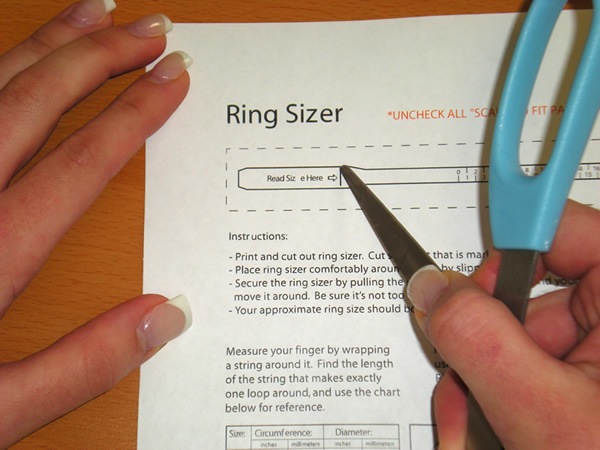 Make a small slit in the paper sizer...